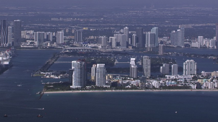 HD stock footage aerial video of flying by South Beach high-rises on the coast, Florida Aerial Stock Footage | CAP_020_022
