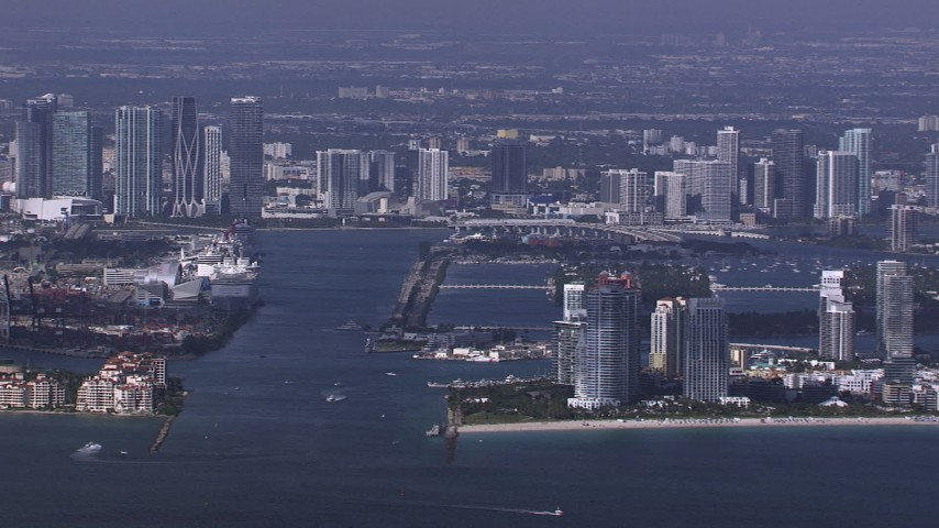 HD stock footage aerial video of flying by South Beach high-rises with view of downtown skyline, Miami, Florida Aerial Stock Footage | CAP_020_023