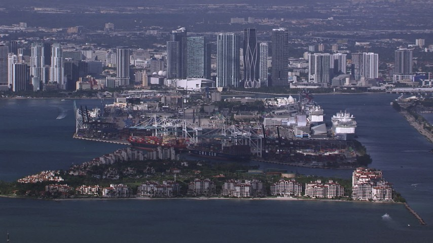 HD stock footage aerial video of the port behind Fisher Island, downtown skyline in background, Miami, Florida Aerial Stock Footage | CAP_020_025