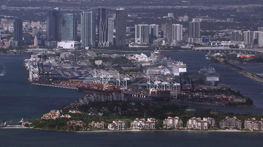 HD stock footage aerial video of a view of Fisher Island, Port of Miami and downtown skyline, Florida Aerial Stock Footage | CAP_020_027