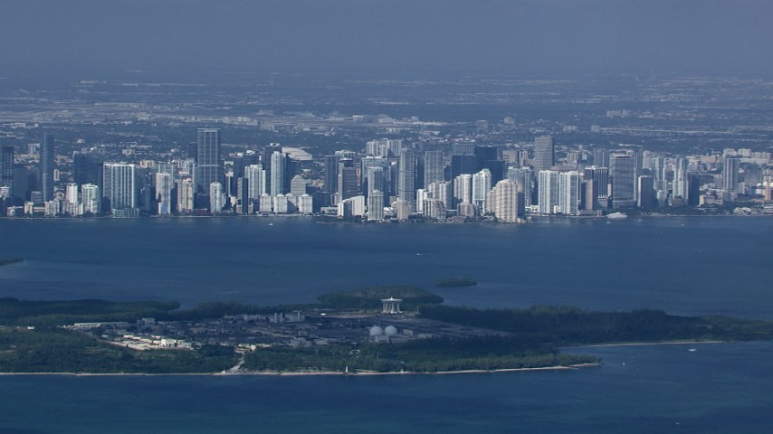 HD stock footage aerial video zoom to a closer view of the Downtown Miami skyline across Biscayne Bay, Florida Aerial Stock Footage | CAP_020_029