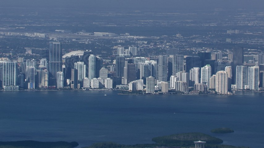 HD stock footage aerial video of the Downtown Miami skyline across Biscayne Bay, Florida Aerial Stock Footage | CAP_020_030