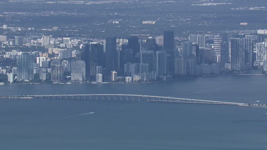 HD stock footage aerial video of the city's skyline behind the Rickenbacker Causeway, Miami, Florida Aerial Stock Footage | CAP_020_042