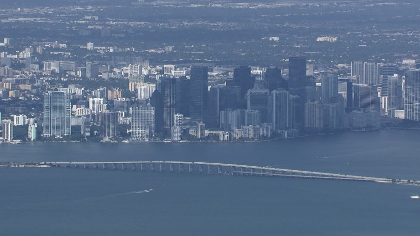 HD stock footage aerial video of a wide view of the city's skyline behind the Rickenbacker Causeway, Miami, Florida Aerial Stock Footage | CAP_020_043