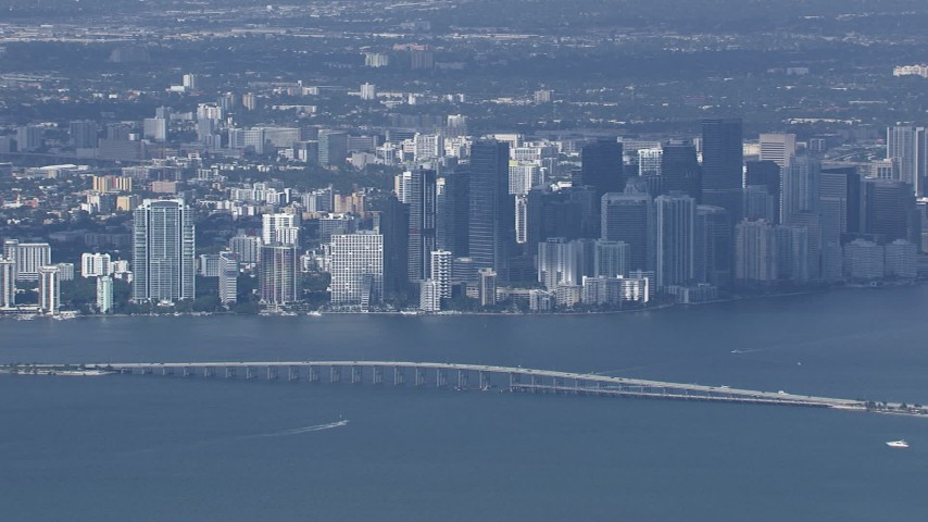 HD stock footage aerial video of flying by the city's skyline behind the Rickenbacker Causeway, Miami, Florida Aerial Stock Footage | CAP_020_044