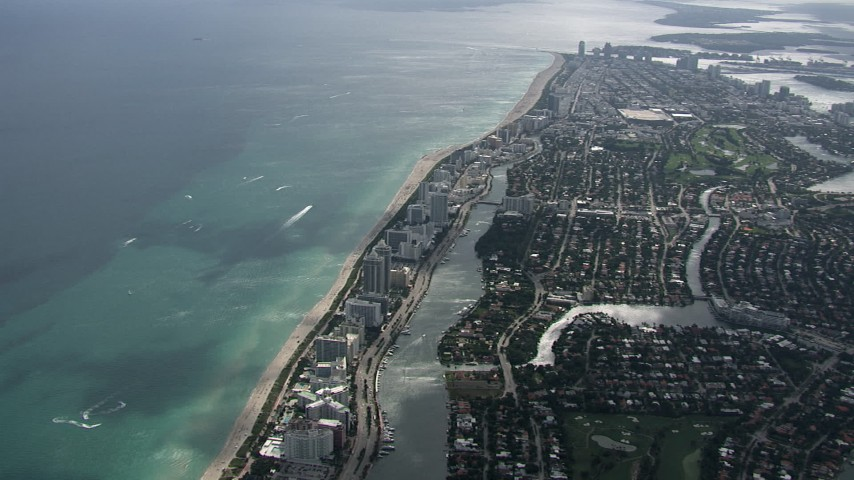 HD stock footage aerial video of flying over Miami Beach toward South Beach, Florida Aerial Stock Footage   CAP_020_055
