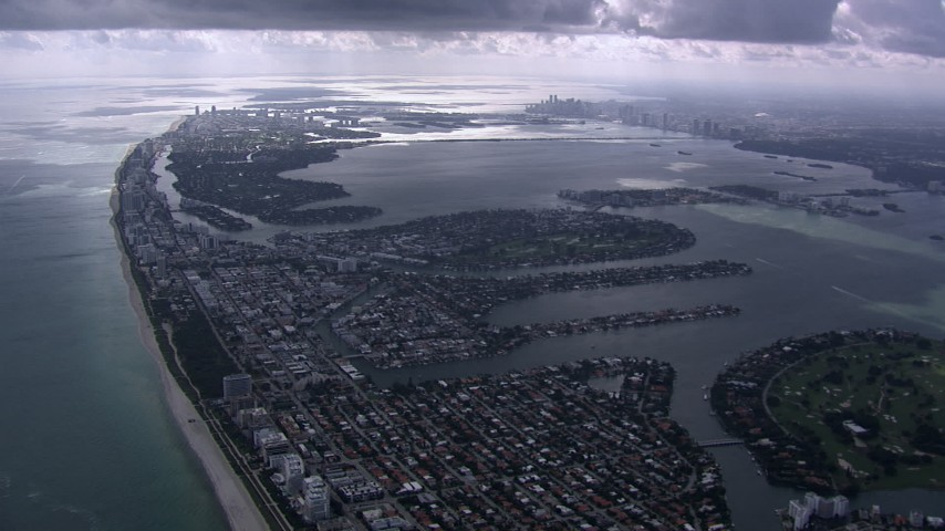 HD stock footage aerial video of flying over Miami Beach toward Biscayne Bay and Downtown Miami, Florida Aerial Stock Footage | CAP_020_059