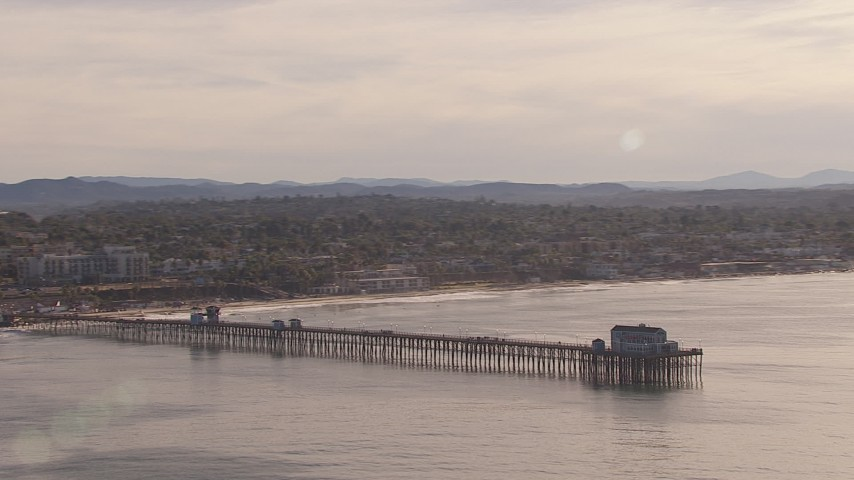 HD stock footage aerial video of flying away from Oceanside Pier with view of the community of Oceanside, California Aerial Stock Footage | CAP_021_025