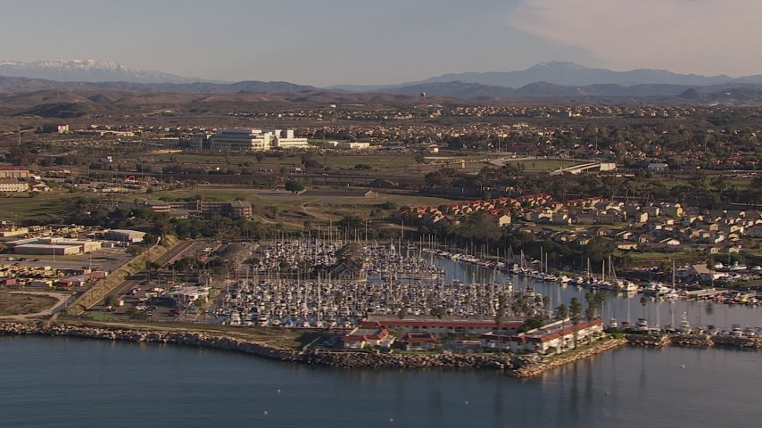 HD stock footage aerial video of a marina and oceanfront hotel in Oceanside, California Aerial Stock Footage | CAP_021_026