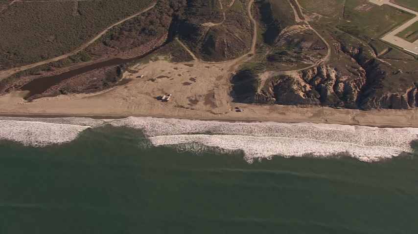 HD stock footage aerial video of flying by an empty strip of beach on the coast, Oceanside, California Aerial Stock Footage | CAP_021_037