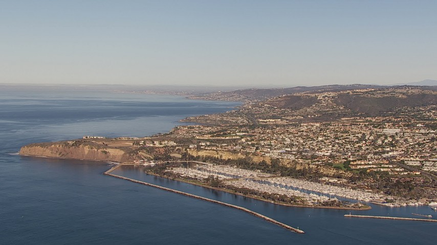 HD stock footage aerial video of flying toward the harbor and coastal neighborhoods in Dana Point, California Aerial Stock Footage | CAP_021_060