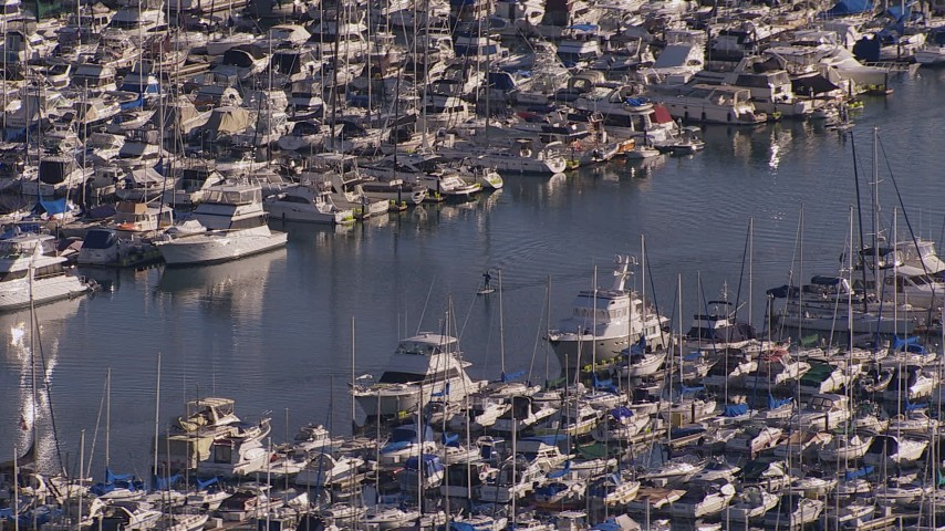 HD stock footage aerial video of flying away from yachts and sailboats at the harbor in Dana Point, California Aerial Stock Footage | CAP_021_063