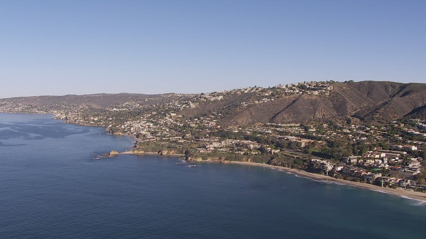 HD stock footage aerial video approach hillside homes and coastal neighborhoods in Laguna Beach, California Aerial Stock Footage | CAP_021_067