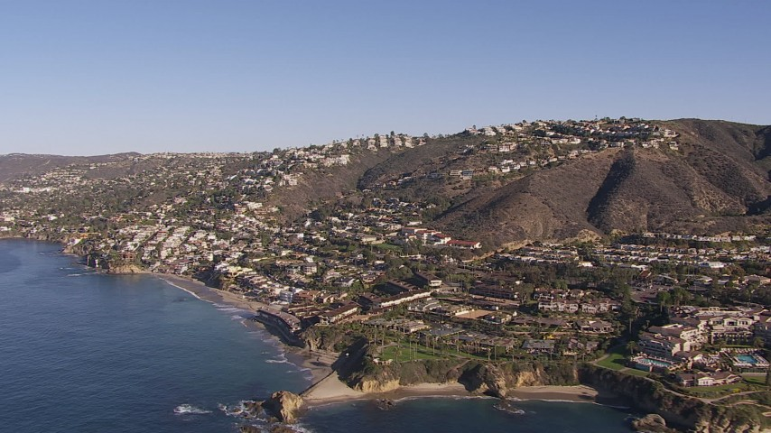 HD stock footage aerial video flying by hillside homes and coastal neighborhoods in Laguna Beach, California Aerial Stock Footage | CAP_021_068