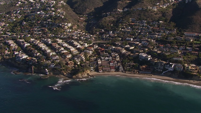 HD stock footage aerial video flying by beach and oceanfront mansions in Laguna Beach, California Aerial Stock Footage | CAP_021_069