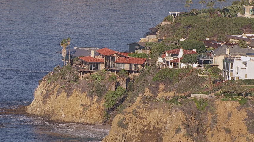 HD stock footage aerial video of an oceanfront mansion on a cliff in Laguna Beach, California Aerial Stock Footage | CAP_021_071