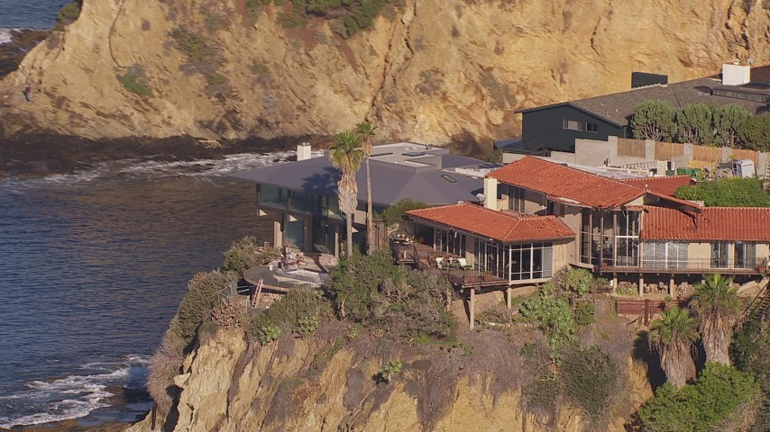 HD stock footage aerial video of orbiting clifftop mansions overlooking the ocean, Laguna Beach, California Aerial Stock Footage | CAP_021_072