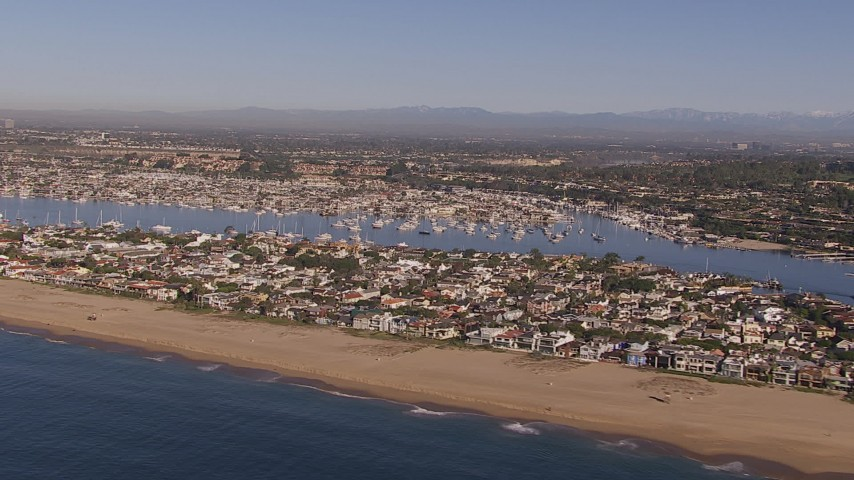 HD stock footage aerial video of flying by the beach and bay by coastal neighborhoods, Newport Beach, California Aerial Stock Footage | CAP_021_076