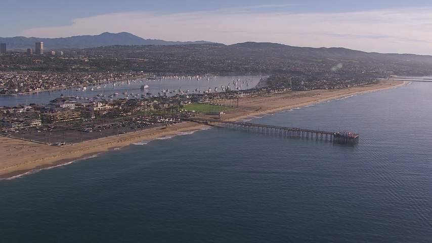 HD stock footage aerial video fly away from pier by the beach and coastal neighborhoods, Newport Beach, California Aerial Stock Footage | CAP_021_078
