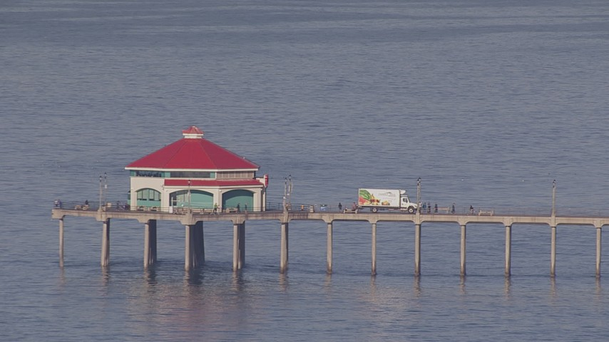 HD stock footage aerial video truck backing up to diner on a pier, Huntington Beach, California Aerial Stock Footage | CAP_021_079