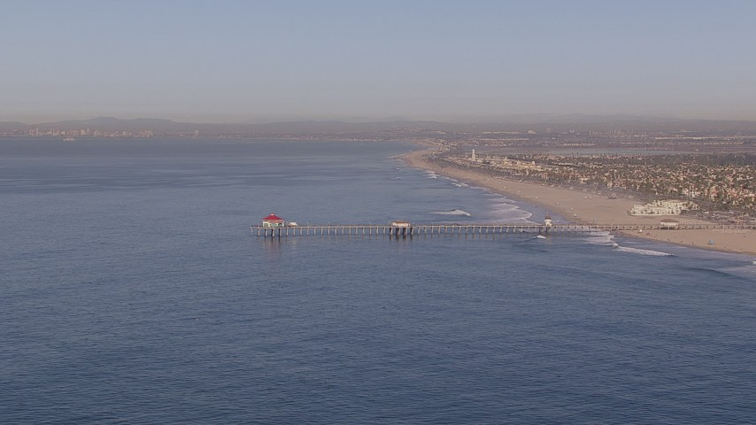 HD stock footage aerial video of approaching a diner on a pier, Huntington Beach, California Aerial Stock Footage | CAP_021_080
