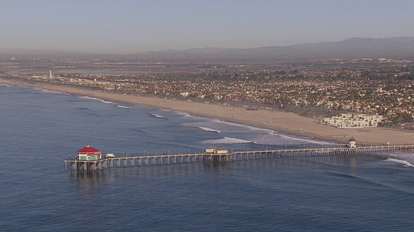 HD stock footage aerial video of flying toward a diner on a pier, Huntington Beach, California Aerial Stock Footage | CAP_021_081