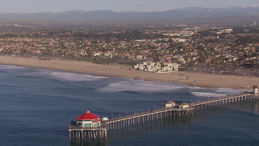 HD stock footage aerial video of orbiting a diner on a pier, Huntington Beach, California Aerial Stock Footage | CAP_021_082