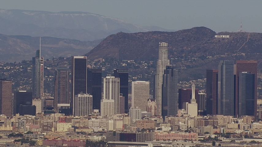 HD stock footage aerial video of the city's skyline and Hollywood Sign, Downtown Los Angeles, California Aerial Stock Footage | CAP_021_086