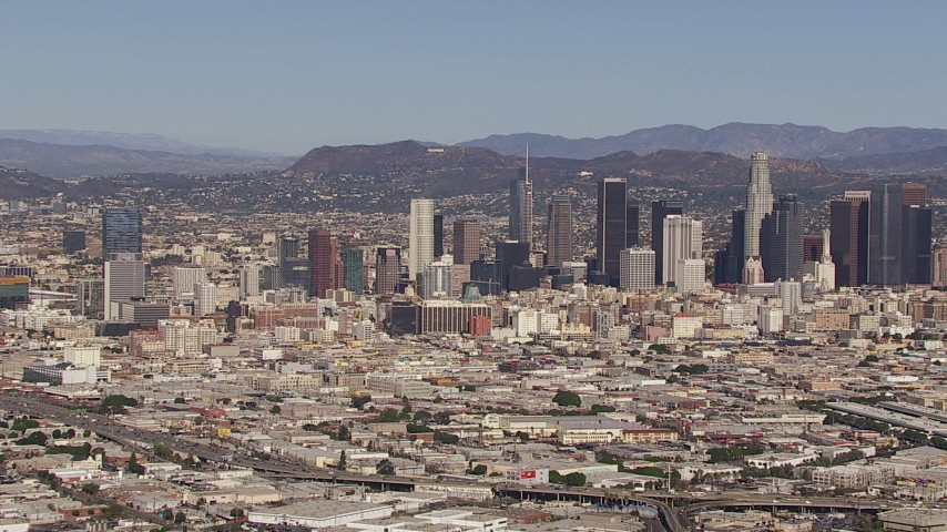 HD stock footage aerial video of approaching the city's skyline and Hollywood Sign, Downtown Los Angeles, California Aerial Stock Footage | CAP_021_089