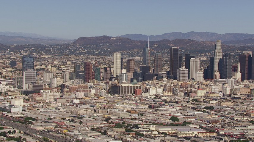 HD stock footage aerial video of flying toward the city's skyline and Hollywood Sign, Downtown Los Angeles, California Aerial Stock Footage | CAP_021_090