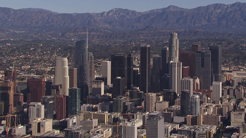 HD stock footage aerial video of flying by tall skyscrapers in the city's skyline, Downtown Los Angeles, California Aerial Stock Footage | CAP_021_095
