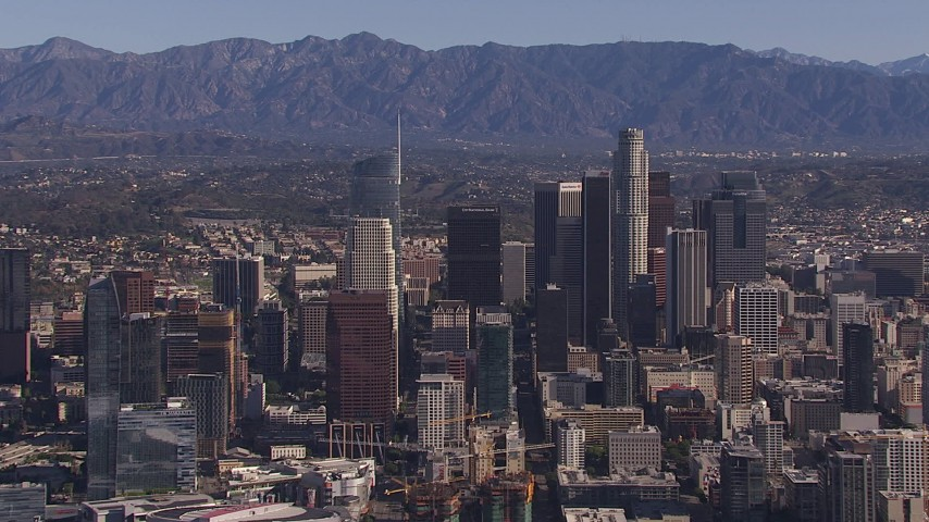 HD stock footage aerial video of passing by tall skyscrapers in the city's skyline, Downtown Los Angeles, California Aerial Stock Footage | CAP_021_096