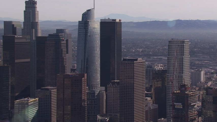 HD stock footage aerial video zoom in on Wilshire Grand Center skyscraper, Downtown Los Angeles, California Aerial Stock Footage | CAP_021_101