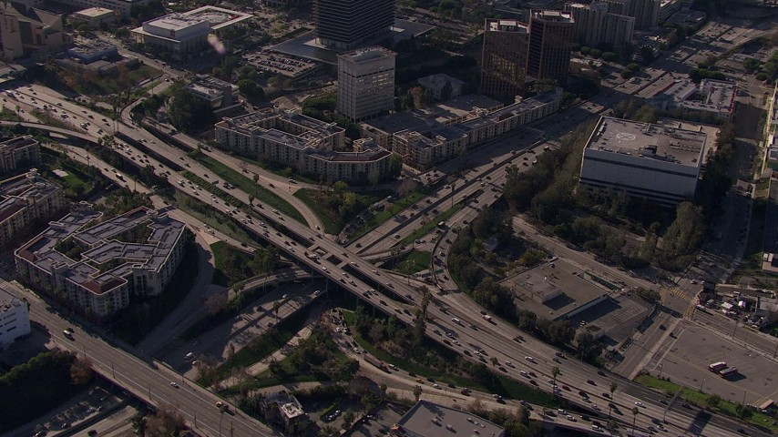 HD stock footage aerial video orbit the 101 / 110 interchange with heavy traffic, tilt to reveal skyline, Downtown Los Angeles, California Aerial Stock Footage | CAP_021_107