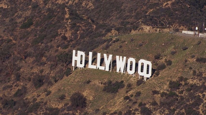 HD stock footage aerial video of slowly approaching the famous Hollywood Sign, Los Angeles, California Aerial Stock Footage | CAP_021_116