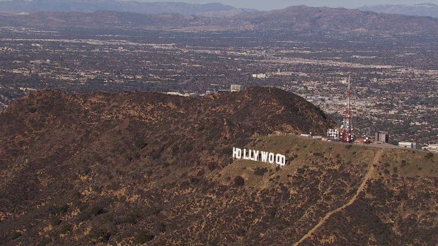 HD stock footage aerial video of slowly flying toward the famous Hollywood Sign, Los Angeles, California Aerial Stock Footage | CAP_021_117