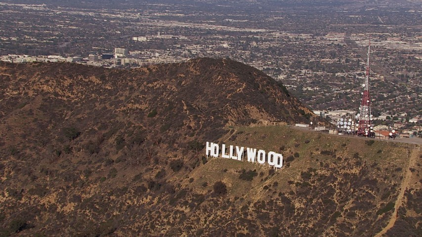 HD stock footage aerial video of orbiting the famous Hollywood Sign, Los Angeles, California Aerial Stock Footage | CAP_021_118