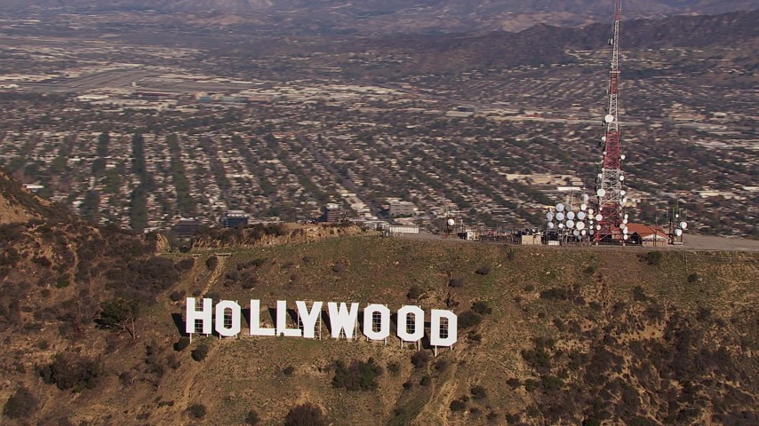 HD stock footage aerial video of circling the famous Hollywood Sign, Los Angeles, California Aerial Stock Footage | CAP_021_119