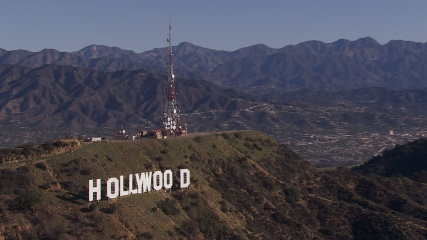 HD stock footage aerial video of orbiting the famous Hollywood Sign, Los Angeles, California Aerial Stock Footage | CAP_021_120