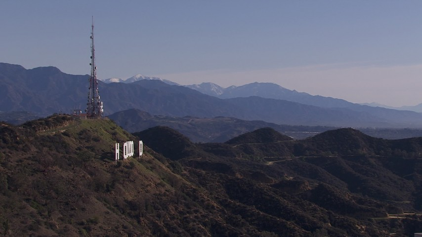 HD stock footage aerial video of the famous Hollywood Sign and distant mountains, Los Angeles, California Aerial Stock Footage | CAP_021_121
