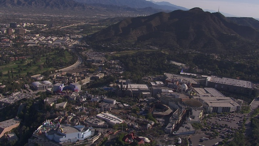 HD stock footage aerial video of orbiting Universal Studios Hollywood theme park, Universal City, California Aerial Stock Footage | CAP_021_124