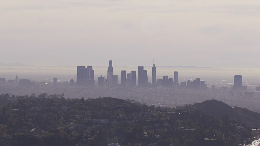 HD stock footage aerial video of a wide view of the city's skyline on a hazy day, Downtown Los Angeles, California Aerial Stock Footage | CAP_021_127