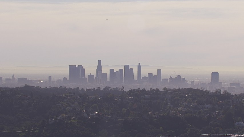 HD stock footage aerial video of a wide view of the city's skyline on a hazy day, seen from Hollywood Hills, Downtown Los Angeles, California Aerial Stock Footage | CAP_021_128