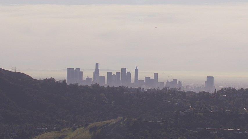 HD stock footage aerial video of the city's skyline on a hazy day, seen from Hollywood Hills, Downtown Los Angeles, California Aerial Stock Footage | CAP_021_129