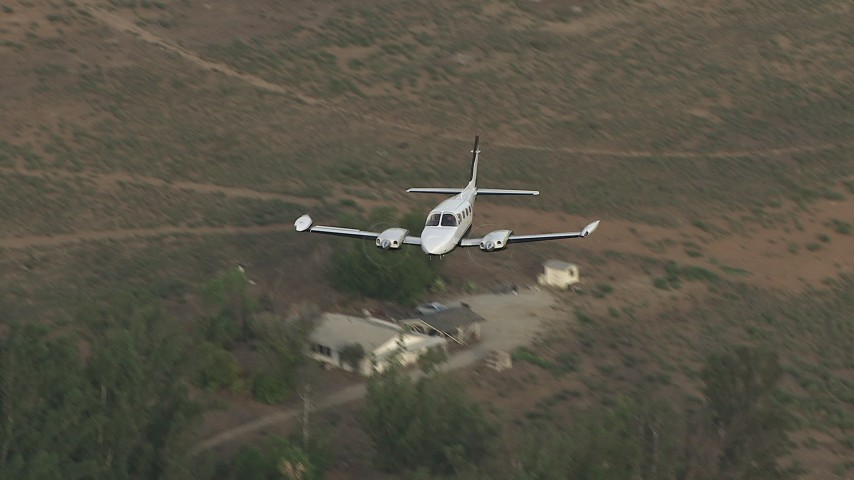 HD stock footage aerial video of flying over rural neighborhood, revealing Cessna 340, Perris, California Aerial Stock Footage | CBAX01_009