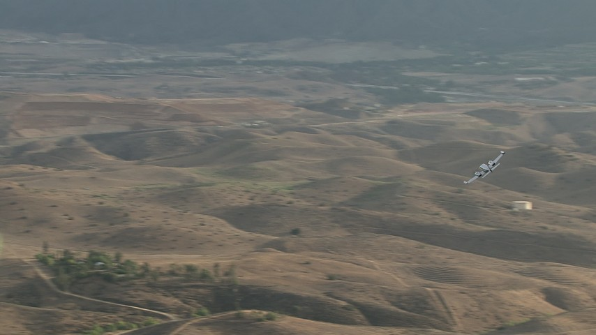 HD stock footage aerial video of a Cessna 340 flying across hazy hills, Perris, California Aerial Stock Footage | CBAX01_029