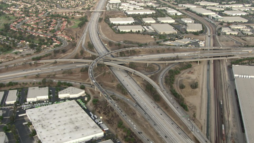 HD stock footage aerial video of fly away from Interstate 15 and Highway 91 interchange, hazy, Corona, California  Aerial Stock Footage | CBAX01_031