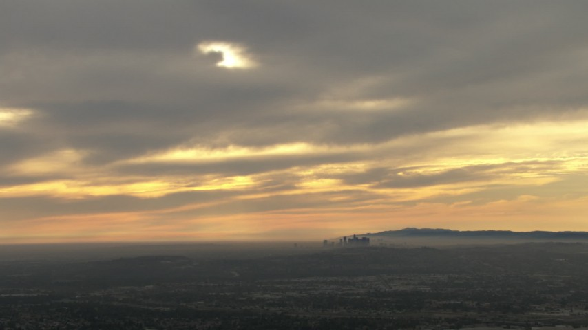 HD stock footage aerial video of smoggy skyline in the distance, cloudy, Downtown Los Angeles, California, sunset Aerial Stock Footage | CBAX01_078