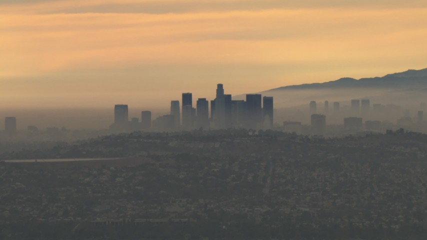 HD stock footage aerial video of passing the smoggy skyline, clouds, Downtown Los Angeles, California, sunset Aerial Stock Footage | CBAX01_081