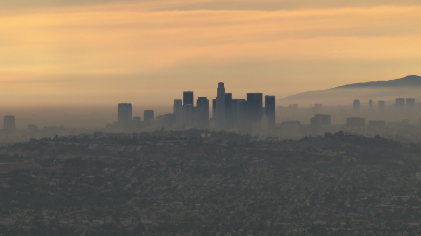HD stock footage aerial video of a smoggy skyline and clouds, Downtown Los Angeles, California, sunset Aerial Stock Footage | CBAX01_083